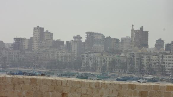 The town of Alexandria shows dimly through exhaust gas.
