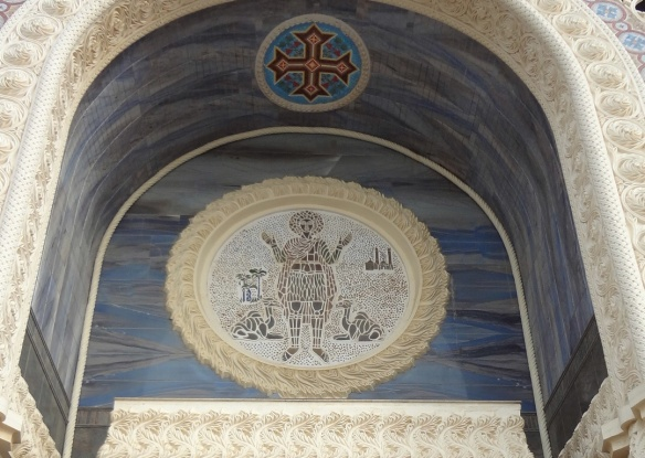 Fresco of Menas on the facade of the church