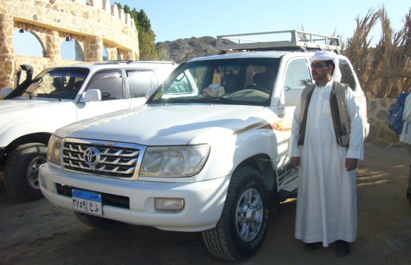 My car Toyota Land Cruiser and the driver.