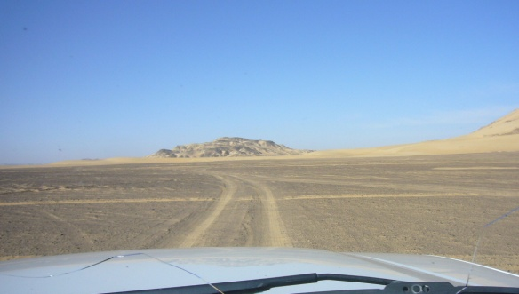 Running in the desert. There is a crack in the windscreen.