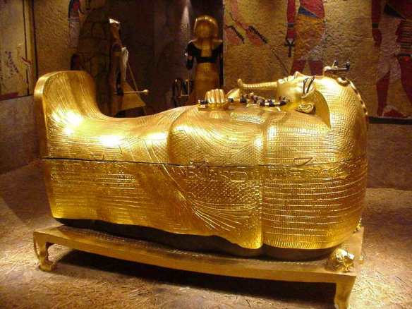Second sarcophagus (coffin), Tutankhamun wearing nemes headdress and holding crook and flail.