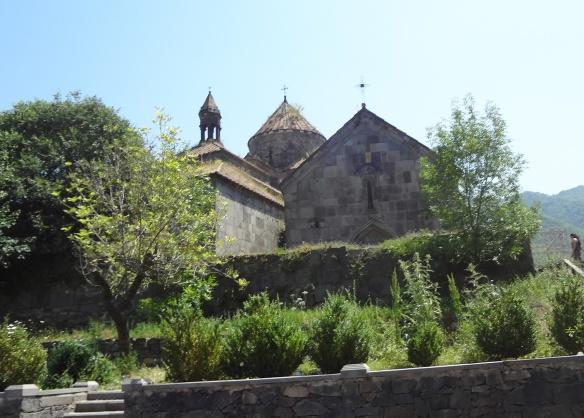 The monastery nestles among the woods.