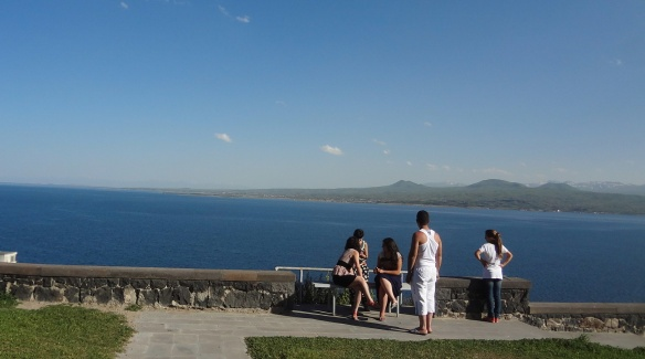 Locals relax at the shore of Sevan Lake