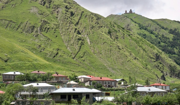 Holy Trinity Church on the hill and Kazbegi village