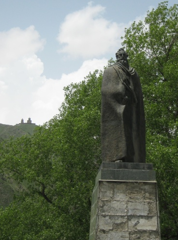 The statue of Alexander Kazbegi on the center of the village