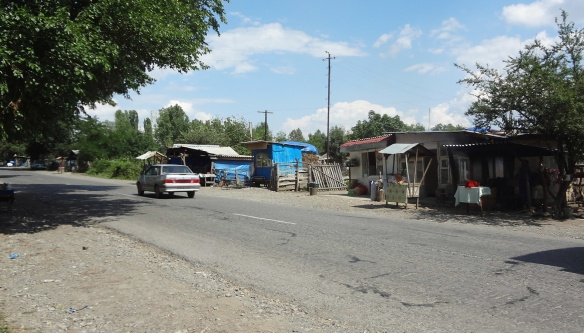 Shabby makeshift huts along the road