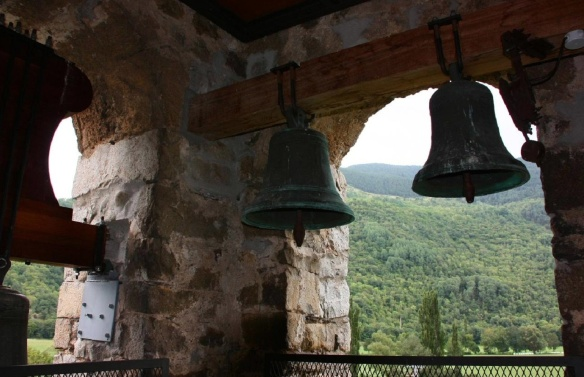Good used old bells in a rusted church in a little village in the shadow of Pyrenees.