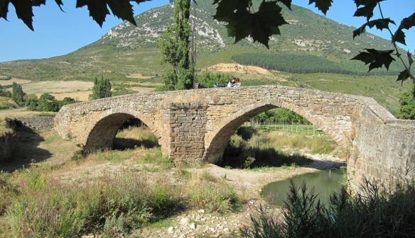 Medieval stone bridge across the river (Rio Elorz), Monreal.