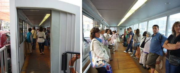 Passengers go on board the cabins on both side.