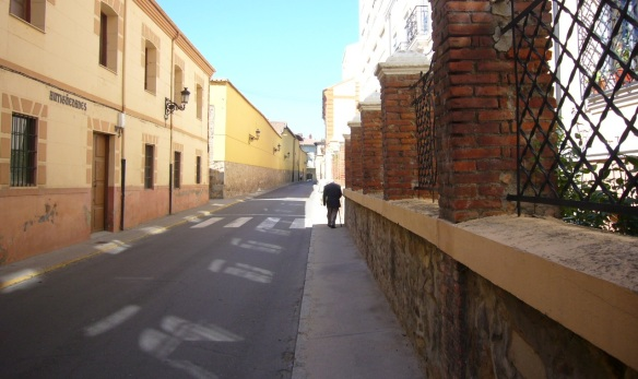 Greeted with an old man in a street, the retreating figure.