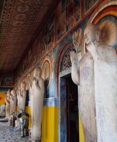 Buddhist images arranged in the corridor of the Buddhist temple adjacent to the Ruwanweli Saya  Dagoba.