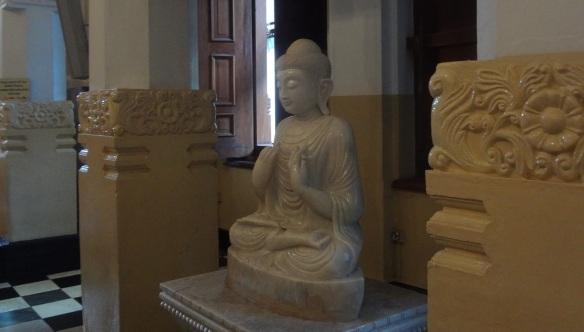 The kindly Buddha image on the cloister.