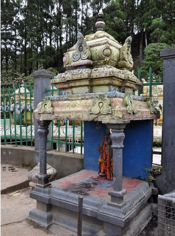 There is a small shrine in front of the Hanuman Temple Nuwara Eliya.