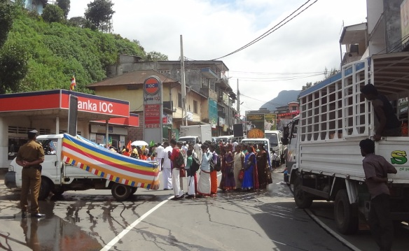 A strange parade appeared in front of my car. It blocked the road.