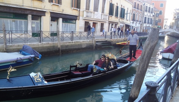 Young upstart couple enjoys a gondola.
