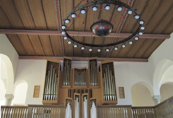 Organ on gallery and illuminated ring on the ceiling
