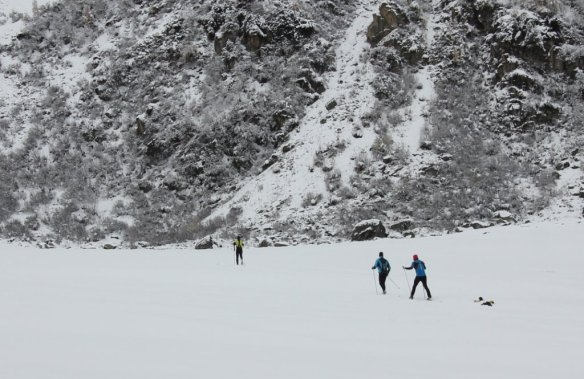 There were young men enjoying Nordic skiing.