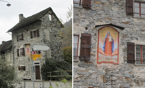 Traditional stone house with the fresco of Madonna and Childin in Sonogno
