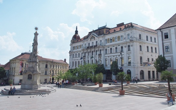 Széchenyi Square; The statue of Trinity and the Pécs County House.