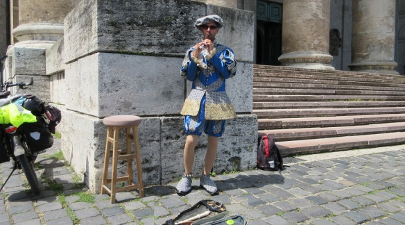 Local musician, he is playing folk music in front of the cathedral.