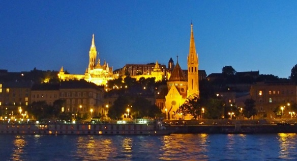 Matthias Church on the hill and Calvinism Church on the bank of the Danube.