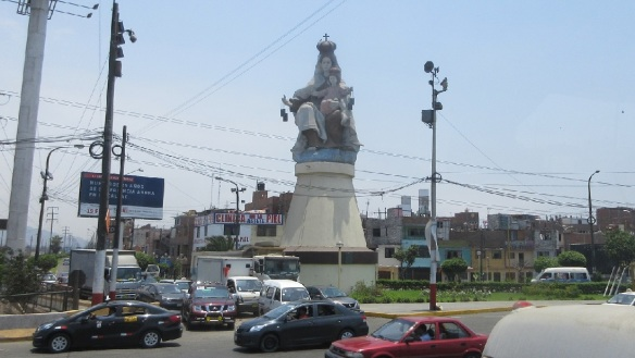 There is a statue of the Virgin Mary. Driving manner of this people are not good