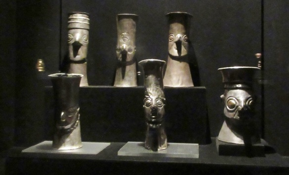 Chimú culture, sheet silver, hammer-molded drinking cup depicting a stylized human head.