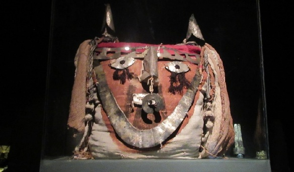 Ancient Pre-Columbian Incan mask archaeological artifact.